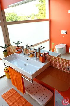 Fresh Clementine bathroom. I like the glass tile backsplash and wall color.