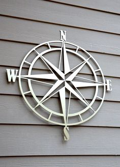 24 or 34 diameter metal cut Nautical Compass Rose wall art, made from 1/8 Aluminum and powder coated for a durable indoor/outdoor finish. Item shown with Gold powder coating. This listing is offering Gold, Chrome, White, Black or Translucent Copper Powder Coating. Other colors are available upon request.  Measurement is made at the diameter of the largest circle. The directional letters add to the overall measurement.  Sizes Available:  Custom sizes available upon request. Contact f...