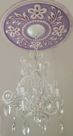 Ceiling Medallion by Marie Ricci. Shown in lilac distressed with 4 arm white chandelier. www.mariericci.com