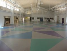 School floor colored with water based stains. Tyson's Inc in Kailua, HI.