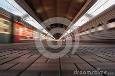 A blurred view of a railway station with trains in Moscow