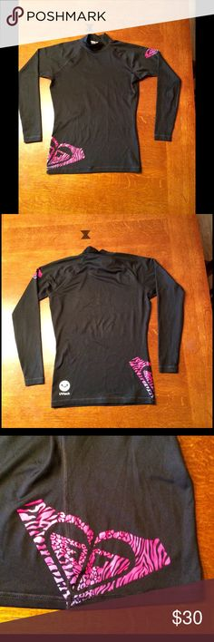 Cute Roxy rash guard shirt!  Super cute Roxy rash guard shirt in size 4.  Across chest measures 15 3/4 inches and length from top of shoulder to bottom measures 22 inches.  Design on left upper arm and right bottom of shirt.  UV tech fabric.  Shirt is in excellent condition.  Very minimal cracking to round symbol above the UVtech - not noticeable. Roxy Swim