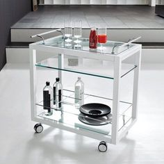 Profil Bar Cattelan Italia  Its profile is framed by white or black wood. Steel elements stand out while the rest of the bar is transparent. Profil Bar is both dynamic and modern and everything is controlled. It features a pullout tray for major practicality and convenience.  http://www.martinelstore.com/en/prod/accessories/trolley-bar/profil-bar-cattelan-italia.html