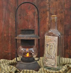 Antique Lantern Antique Lanterns, Candle Lanterns, Candles, The Great Outdoors, Whiskey Bottle, Bathrooms, Lights, Rustic, House Styles