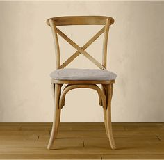 RH's Madeleine Side Chair:Modeled after the most popular café chair in Europe, our versatile X-back dining chair pays homage to the bentwood tradition popularized by Thonet in 19th-century Austria. Handsomely distressed with a weathered finish.