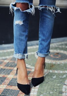 {Distressed denim and pumps.}