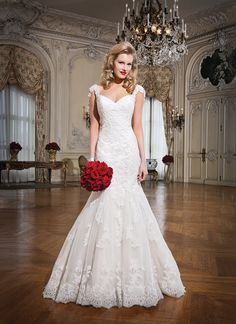 Justin Alexander Wedding Dress Style 8758 Alencon lace fit and flare dress emphasized by a sweetheart neckline.