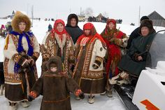 A Khanty family in traditional dress at a Spring festival in the village of Pitlyar. Yamal, Russia