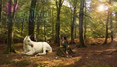 The last unicorn- digital background that can be used in photography. It can be purchased here without the watermark and woman in the photo. https://www.etsy.com/au/listing/449835088/the-last-unicorn?ref=shop_home_active_7