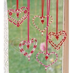 This looks easy enough to make with wire, beads, and cord or ribbon to hang them.