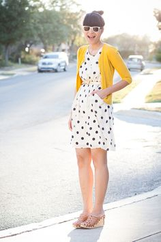 Polka dots + the classic color combination of yellow and navy + bun = solid librarian outfit.  Except perhaps swap those strappy platforms out for some sensible flats.
