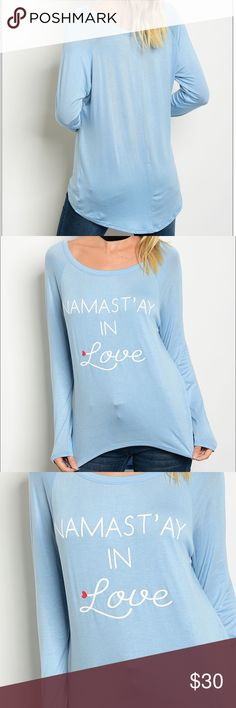 """Graphic Print Shirt """"Namast'ay in Love"""" """"Namast'ay In Love Shirt"""" Long sleeve jersey graphic tee. Fabric Content: 96% RAYON 4% SPANDEX Measurements: L: 28"""" B: 38"""" W: 36"""" Tops"""