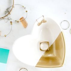 This dollar store heart trinket dish gets a chic and easy make over by dipping it in gold paint. Perfect to gift for Valentine's Day!