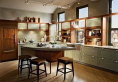 Painted Willow is warmed by a Cinnamon finish and natural light in this contemporary L-shaped kitchen.