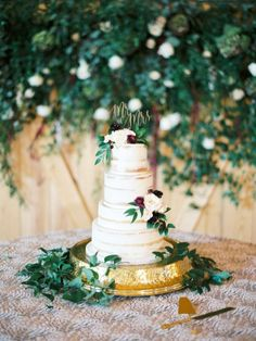 Four tier naked wedding cake with greenery: http://www.stylemepretty.com/2017/03/03/burgundy-navy-texas-fall-wedding/ Photography: Michelle Boyd - http://www.michelleboydphotography.com/