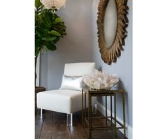 Lucite legs, starburst mirror and gorgeous quartz crystal, natural fig tree