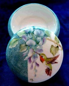 """Signed hand painted 3-1/2"""" diameter porcelain box. Decorated with wisteria and a hummingbird. $28.95 + $5.95 shipping"""