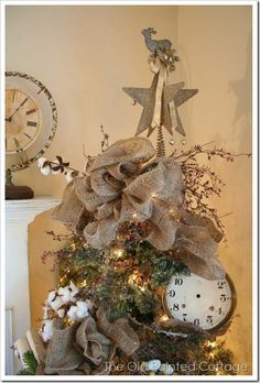 Love the burlap ribbon and the clock in the tree.