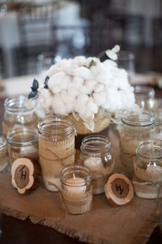 candles in mason jars wrapped with burlap- option also as wedding favors