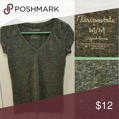 Aeropostale Dark Heathered Grey V-Neck Tee In Good used condition a Dark Pewter Grey Classic V-Neck Tee Shirt.  (Consider bundling to get more value out of the cost of Shipping and feel free to make offers on bundles) Thank you for visiting my closet!! SMOKE FREE CLEAN HOME Aeropostale Tops Tees - Short Sleeve