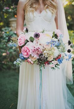 Colorful, Bohemian Mixed Bouquet. A modern bouquet comprises of roses, peonies, dahlias, protea, succulent, delphinium, and tweedia, created by The Bloom Of Time.