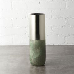 Shop fields brass vase.   Elegant vase with clean lines and shiny gold finish has a fresh-picked surprise––a hand-applied texture that tapers to the base in crisp green.  Done-by-hand finish means each vase is unique.