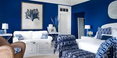 Crisp white and cobalt blue accents fill the guest bedroom of a charming Hamptons home.