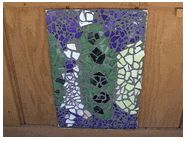 The first and second grade class at odyssey School created these mosaic panels in class during the Winter and then mounted them on the school garden shed during Spring planting.