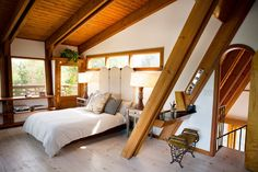 Lovely bedroom. Great architectural details. An Artist's 1963 A-frame Lux Lodge