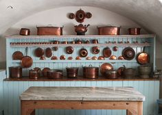 I love the copper on the blue in this kitchen!
