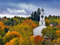 A church surrounded with autumn colors in Wiscasset, Maine *()