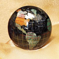 Black Opalite Gemstone Globe Paperweight ... inlaid with more than 25 semi-precious gemstones including lapis, jade, aventurine, picture jasper and mother-of-pearl / Smithsonian Institution shop, Washington, DC, USA