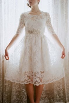 A-line silhouette vintage gown with full lace fabric, features a round neckline, knee length skirt and half length sleeve. The waist is accented with beads, zipper up back. ( Note:Only dress included in original sell, veil, necklace and other accessories not included ) $288.00