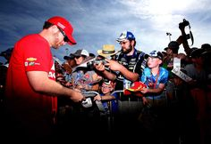 At-track photos: Saturday, Kansas:    Sunday, May 8, 2016  -   Dale Earnhardt Jr., driver of the No. 88 Axalta Chevrolet, meets with fans and signs autographs before the GoBowling 400 at Kansas Speedway.  -   Photo Credit: Photo by Sean Gardner/NASCAR via Getty Images
