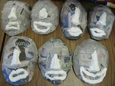 3rd grade paper mache face masks formed with dried toilet paper pulp noses and lips; ready for final two layers of paper mache; lesson by art teacher: Susan Joe