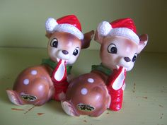 pair of 2 Josef Originals Christmas deer figurines with Santa hats and stockings - Japan. $15.00, via Etsy.