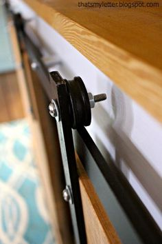 DIY Sliding Barn Door Console Hardware Tutorial How to make your own sliding barn door console hardware using off the shelf supplies from the hardware store. DIY hardware for your sliding barn doors. Sliding Door Hardware, Barn Door Tables, Hardware Diy, Mini Barn, Sliding Doors, Diy Barn Door Hardware, Diy Sliding Barn Door