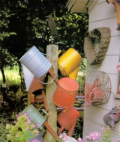 .nice collection of watering cans..love the yellow one!