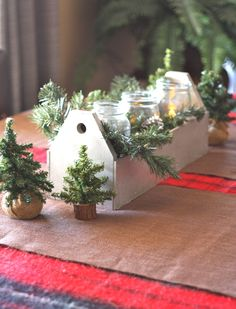 A #tool box, #Mason jars, #mini trees and a blanket from #Goodwill set the stage for a simple and #rustic #centerpiece.  #thrift #Christmas
