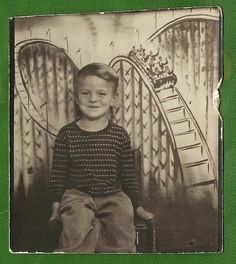 ** Vintage Photo Booth Picture **   Super image of a boy sitting in front of a roller coaster backdrop at an arcade.
