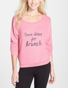 Making a statement with this pink, cozy crewneck that's sure to be relevant every weekend.