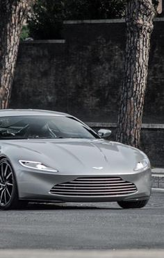 Definition of a Sports Car Aston Martin Db10, Aston Martin Cars, Fancy Cars, Racing Stripes, Sweet Cars, Love Car, Amazing Cars, Awesome, Courses