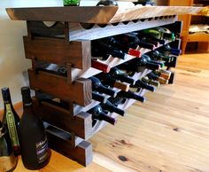 "Crafted of walnut, this custom wine rack features a stacked ""leg"" design with a live edge top."