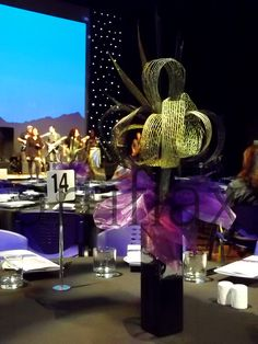 Black, purple and gold hapene flax centrepieces by Artiflax Limited