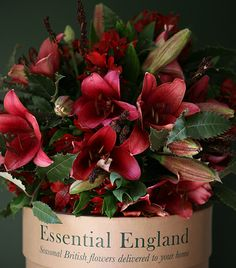LILY AND ALSTROMERIA BOUQUET    Warm up those chilly winter days with our hot pink and burgundy bouquet full of colour and seasonal cheer. Our beautiful flower box contains deep red scented Lilies, red and pink Alstromeria, Zolly and Coffee grass, and is one of our most popular bouquets of the year.