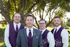 A groom and his men - Ft Collins Colorado - Purple vests and grey suits. Photo By Silver Sparrow Photography