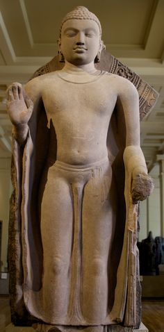 https://flic.kr/p/g7FDQk | Standing Buddha, Sarnath (UP, India), 5th-6th century AD | This standing Buddha statue is made of sandstone. He is depicted with the Abhayamudra (hand gesture of protection, peace, benevolence and dispelling of fear).   Room 33, British Museum, London.