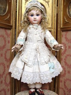 Gorgeous antique closed mouth JUMEAU Bebe, wonderful condition wearing a lovely antique costume