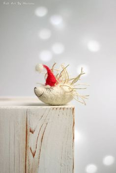 This little needle felted Porcupine was born in Sofia a few days ago. He has red hat and while waiting for Santa hes sleeping on the fireplace. I use felt needle techniques and 100% pure wool form Bulgaria. I dye the wool by myself to achieve the right colors.  Size in centimeters:  6 cm long.  Size in inches:  2.3 long.  Each of my dolls are:  Created with love. Handmade by me. My own model. Made of 100% sheep wool.  I make all my items with love and I hope youll like them.  If you have…