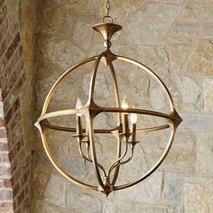 The Lando Orb 4-Light Chandelier creates a light-filled sculptural statement. The orb frame is hand crafted of solid brass with pyramidal joinery and brass candle sleeves. An antique wash is hand applied to give this substantial fixture a vintage luster.